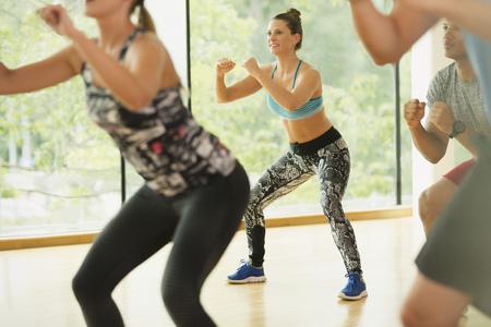 spandex: Smiling woman enjoying aerobics class