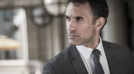 Close up pensive corporate businessman looking away