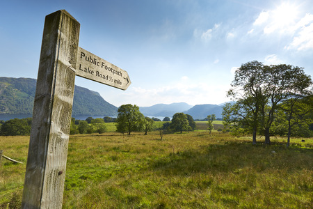 Wooden public footpath signpost in rural Lake District, Ullswater, England