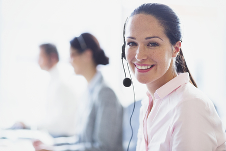 handsfree telephone: Portrait of smiling businesswoman talking on the phone with headset