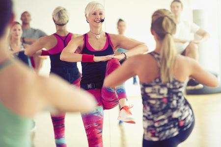 spandex: Fitness instructor leading aerobics class