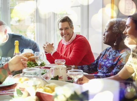 brazilian ethnicity: Portrait smiling man enjoying Christmas dinner at table