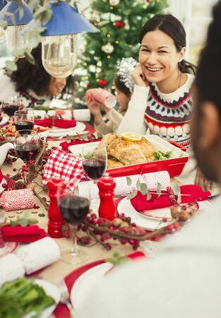 vietnamese ethnicity: Smiling woman enjoying Christmas dinner