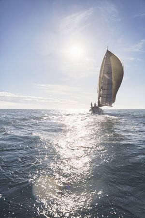 Sailboat on sunny ocean LANG_EVOIMAGES