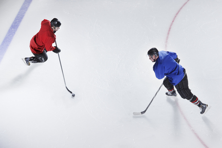 Overhead view hockey opponents with puck