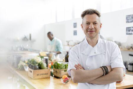 Portrait smiling chef in commercial kitchen LANG_EVOIMAGES