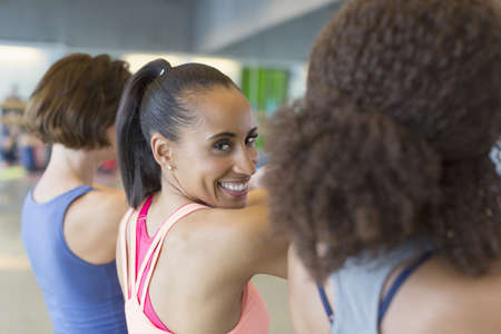 smile close up: Portrait smiling woman in exercise class gym studio