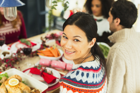 turn table: Portrait smiling woman at Christmas dinner