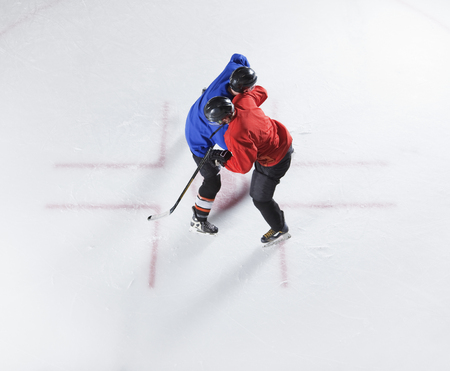 Overhead view hockey opponents colliding LANG_EVOIMAGES
