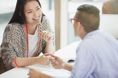 vocational high school: College students talking and studying