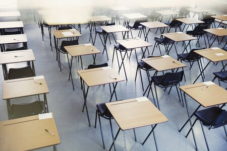 vocational high school: Pens and index cards on desks in empty classroom