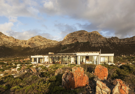path to wealth: Home showcase exterior among craggy landscape
