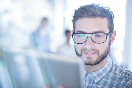 smile close up: Close up businessman with eyeglasses using digital tablet