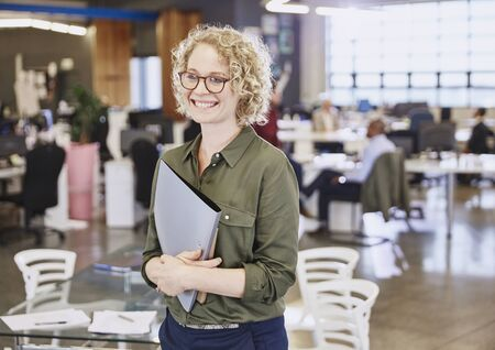 successfulness: Smiling businesswoman in office