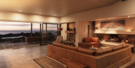 sectional door: Home showcase interior living room overlooking ocean at sunset