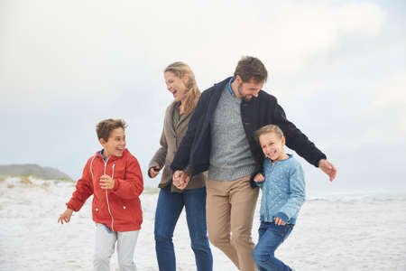girls at the beach series: Playful family on winter beach