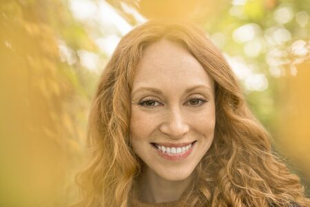 smile close up: Close up portrait smiling woman with red hair