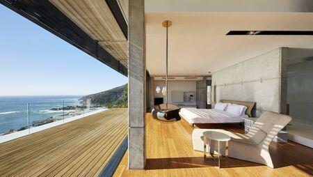 hotel bedroom: Modern luxury bedroom open to patio with sunny ocean view