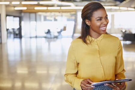 beaming: Smiling businesswoman in office