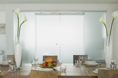 Modern Dining Room With Lily Vases In Home Showcase Interior Stock