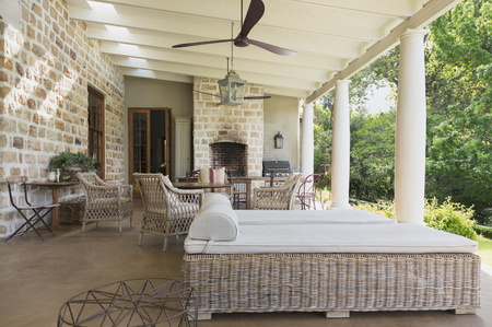 outdoor fireplace: Luxury home showcase patio with stone walls