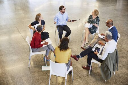 Business people talking in circle meeting