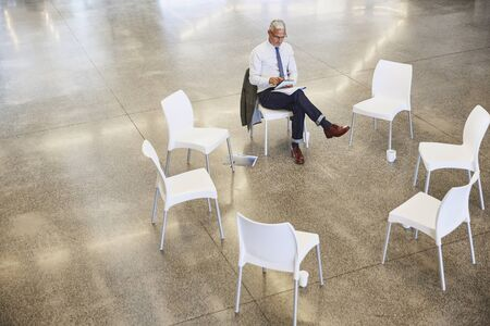 conveniences: Businessman with digital tablet waiting for circle meeting
