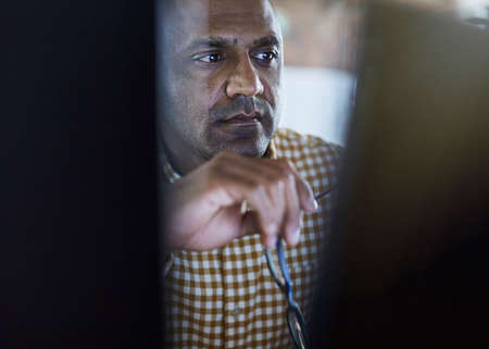tight focus: Serious focused businessman working at computer