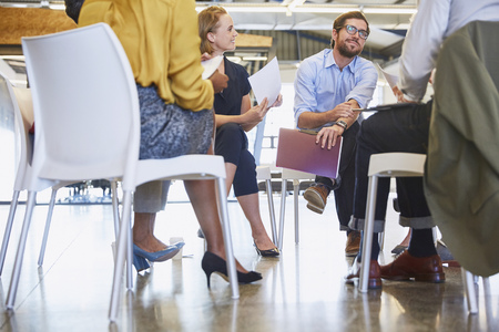 strategizing: Business people talking in meeting circle