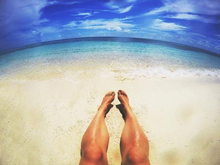 unworried: Man sunbathing on sunny tropical beach