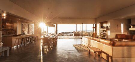 living room design: Sun shining in luxury home