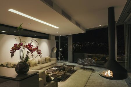 living room design: Modern luxury fireplace and home showcase living room at night