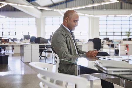 conveniences: Businessman using digital tablet in office