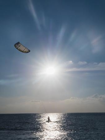 the furlough: Parasailing on ocean under sunny blue sky LANG_EVOIMAGES