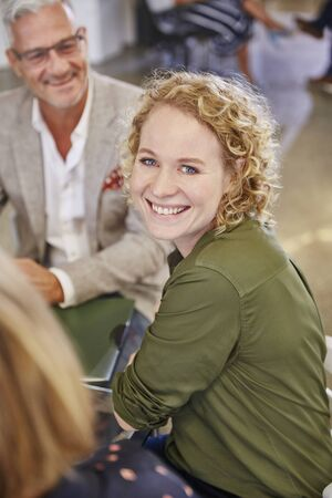 Portrait smiling businesswoman in meeting LANG_EVOIMAGES