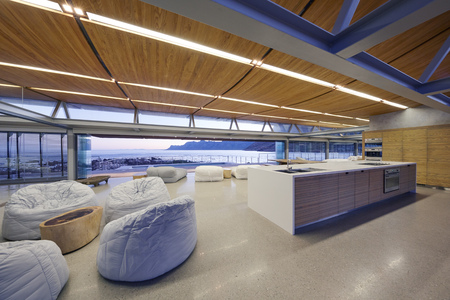 kitchen island: Bean bag chairs in modern luxury hotel space with ocean view