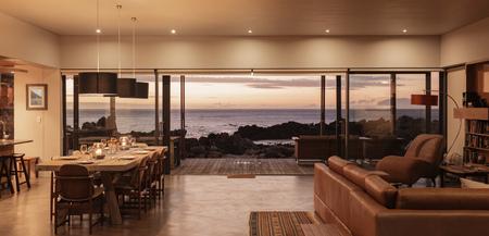 open floor plan: Home showcase interior overlooking ocean at sunset