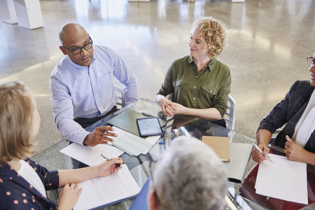 clarifying: Business people talking in meeting