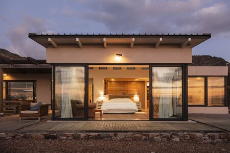 Illuminated Home Showcase Bedroom With Open Patio Doors LANG_EVOIMAGES