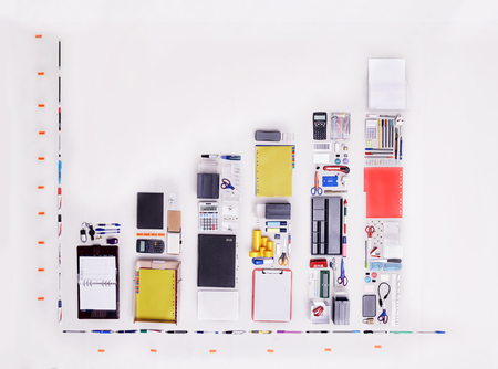 large group of business people: Still life concept office supplies forming bar chart