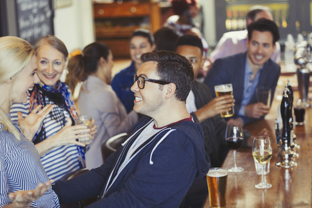 alcohol series: Enthusiastic man and woman greeting in bar