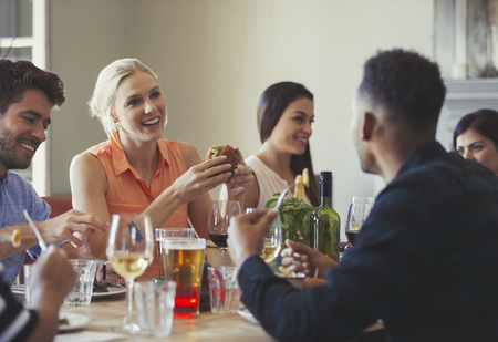 alcohol series: Friends talking and dining at restaurant table