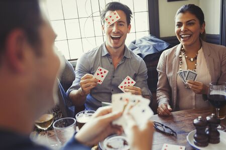 alcohol series: Friends playing Blind Man's Bluff at bar