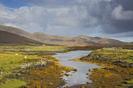 Sunny tranquil view craggy landscape and stream, Loch Aineort, South Uist, Outer Hebrides LANG_EVOIMAGES