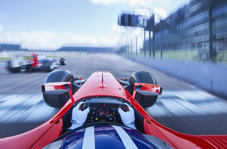 Personal perspective formula one race car driver speeding on race track
