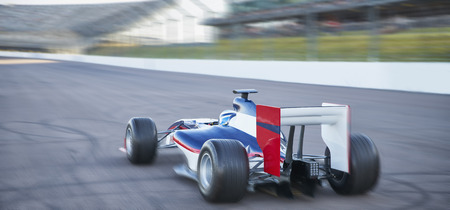 plied: Formula one race car on sports track LANG_EVOIMAGES