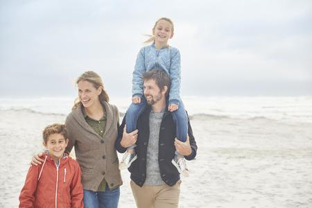 girls at the beach series: Family walking on winter beach