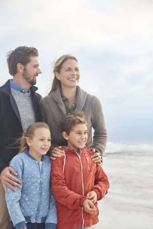 girls at the beach series: Smiling family on winter beach LANG_EVOIMAGES