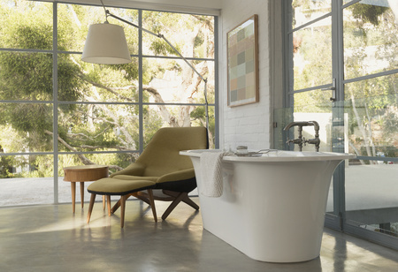 modern bathroom: Soaking tub in home showcase interior bedroom with garden view
