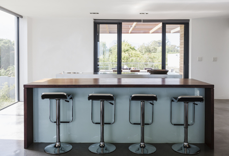 Simple, modern home showcase interior kitchen island with barstools